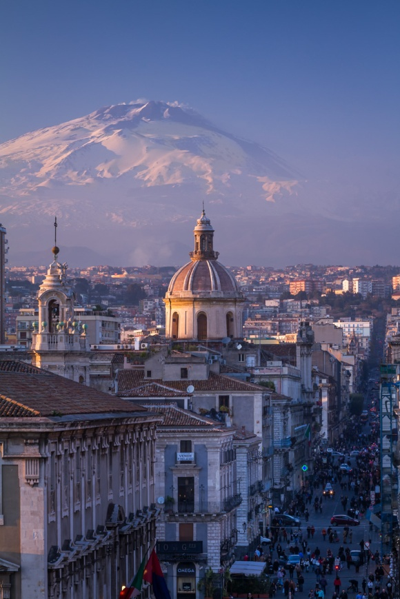 Catania, the city center with Mt. Etna volcano, covered with snow, on the background, Sicily, Italy.