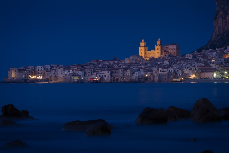 The seaside town of Cefalù withthe illuminated Duomo, Sicily, Italy.