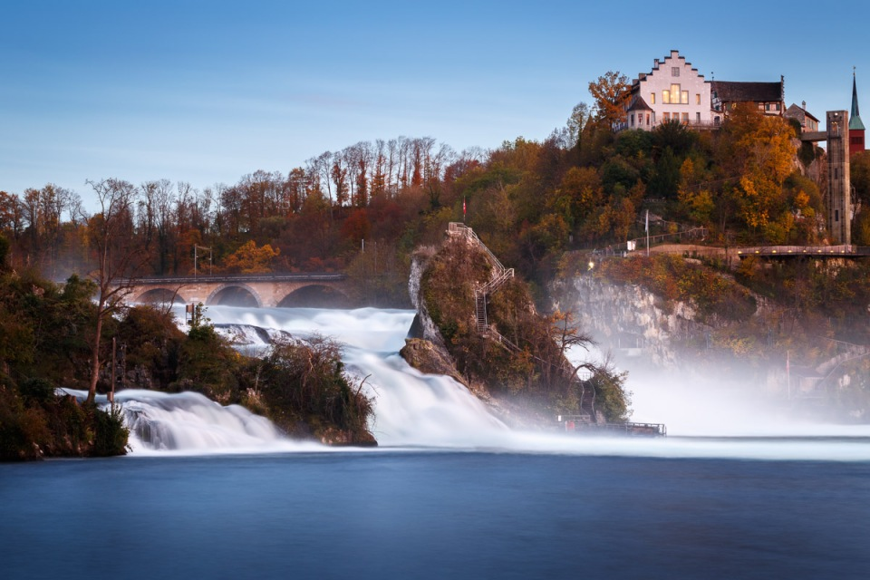 Rhine Falls and Schloss Laufen castle at dusk, Schaffhausen, Switzerland.