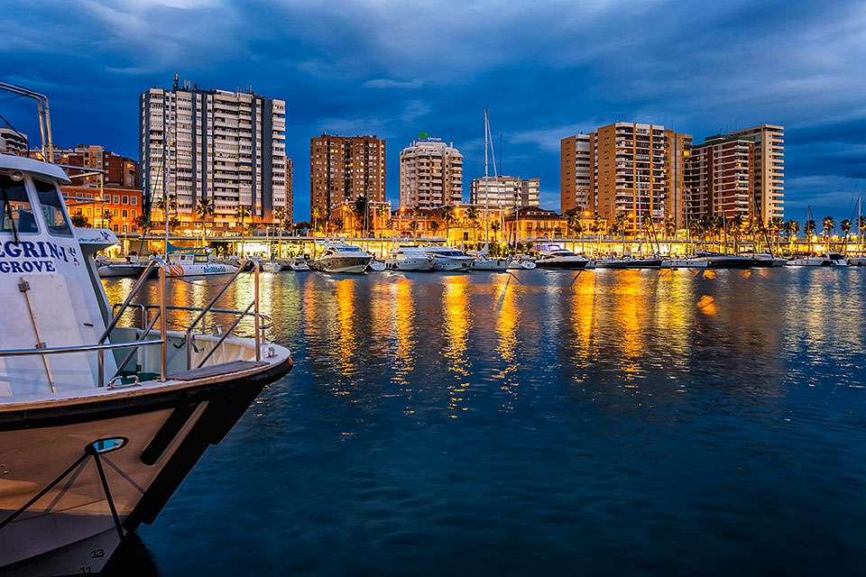 View across marina at dusk, Malaga, Andalusia, Spain.