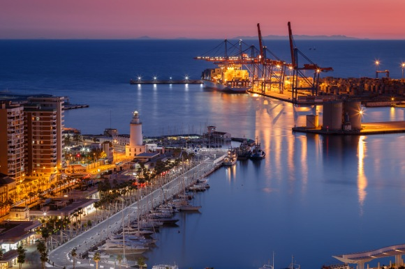 Malaga, view of port and lighthouse at twilight, Andalusia, Spain