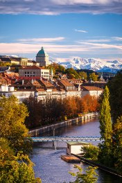 Zurich, view of the Limmat River and the Old Town with snowcapped Alps in the background.