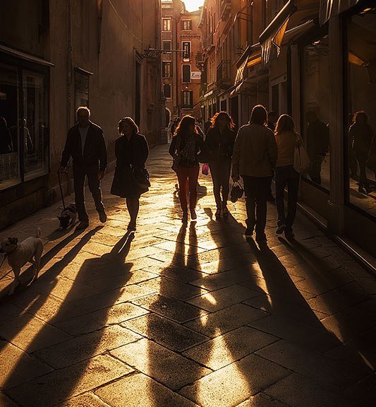 Street scene at sunset, Venice, Italy.