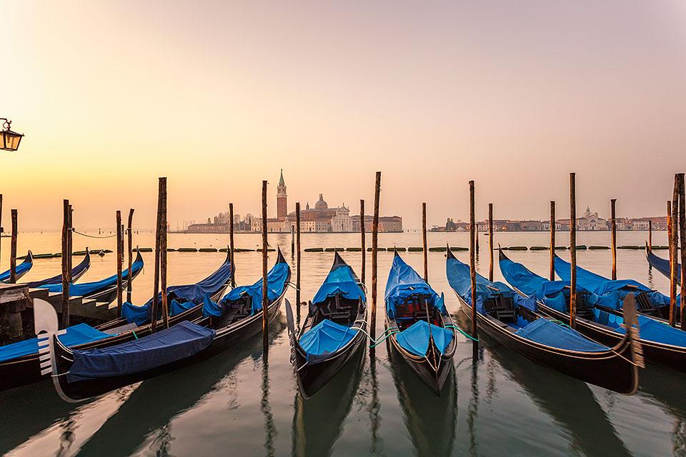 Daybreak view of gondolas from Piazzetta San Marco to Isole of San Giorgio Maggiore, Venice, UNESCO World Heritage Site, Veneto, Italy.