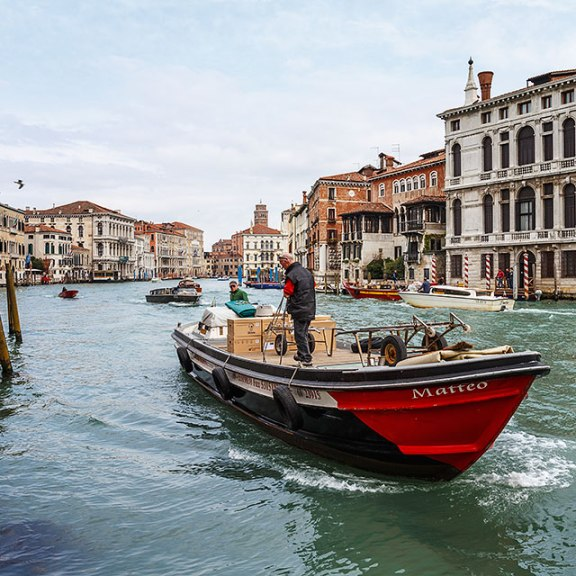 Transport boat on the Grand Canal in Venice, Italy.