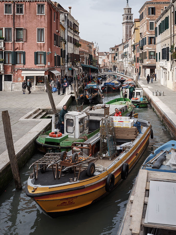 Congestion of boats in the Rio di San Barnaba canal in Venice, Italy.