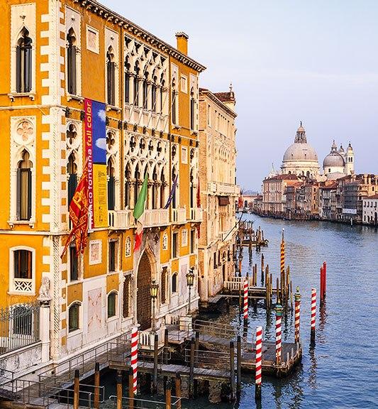 The Grand Canal with Palazzo Cavalli-Franchetti and Santa Maria della Salute church, Venice, Italy.