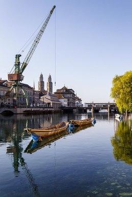 Zurich, the Limmat river with port crane, Switzerland.