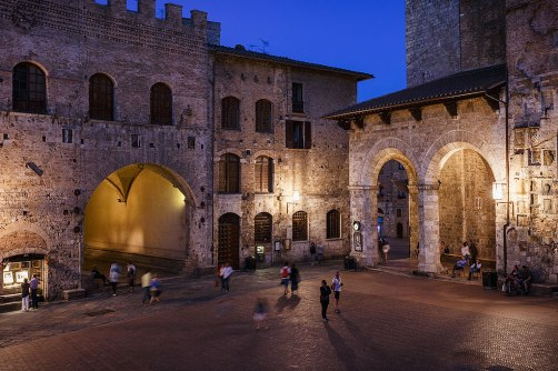 The loggias in Piazza Duomo at night, San Gimignano, Tuscany,