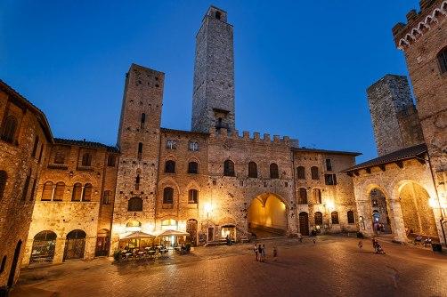 Piazza Duomo in San Gimignano at dusk, Tuscany, Italy
