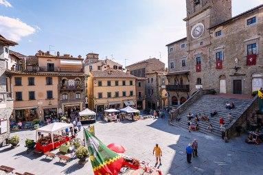 Market in the Piazza della Repubblica in Cortona, Tuscany, Italy.