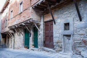 Original brick and overhanging houses in Cortona, Tuscany, Italy.