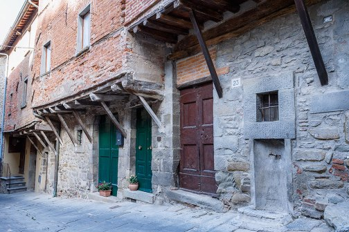 Original brick and overhanging houses in Cortona, Tuscany, Italy.