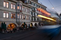 House of the Guild of Carpenters with motion blurred tram, Zurich, Switzerland.