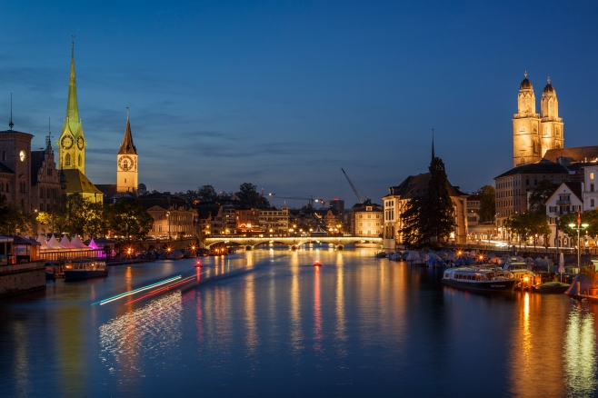 The old town of Zurich at night with the river Limmat.