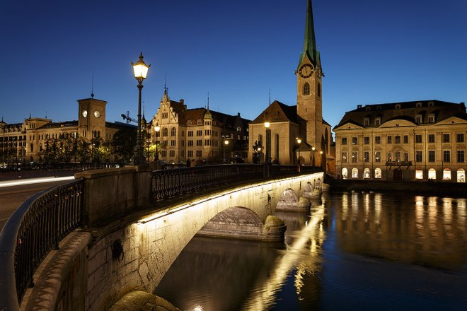 Zurich at night with Fraumunster church, Munsterbrucke and river Limmat, Switzerland
