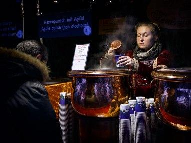 Punch seller at christmas market in Zurich, Switzerland.