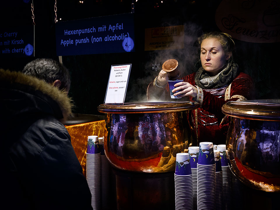 Punch seller at christmas market in Zurich, Switzerland.