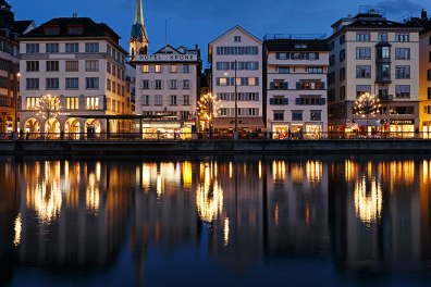 A row of buildings on the riverfront of the river Limmat, Zurich, Switzerland.
