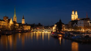 The old town of Zurich at night with the river Limmat, Switzerland.