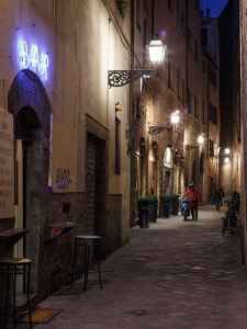 An alley with a small bar at night, Florence, Tuscany, Italy.