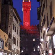 The tower of Palazzo Vecchio lit red to remember the dead in the war in Syria, Florence, Tuscany, Italy.