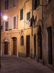 Alley at night, Siena, Tuscany, Italy.