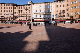 Piazza del Campo, the square with the shadow of the Mangia Tower and Palazzo Pubblico, Siena, Tuscany, Italy.