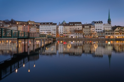 Row of houses of the old town of Zurich reflected on the Limmat River at night,Switzerland.