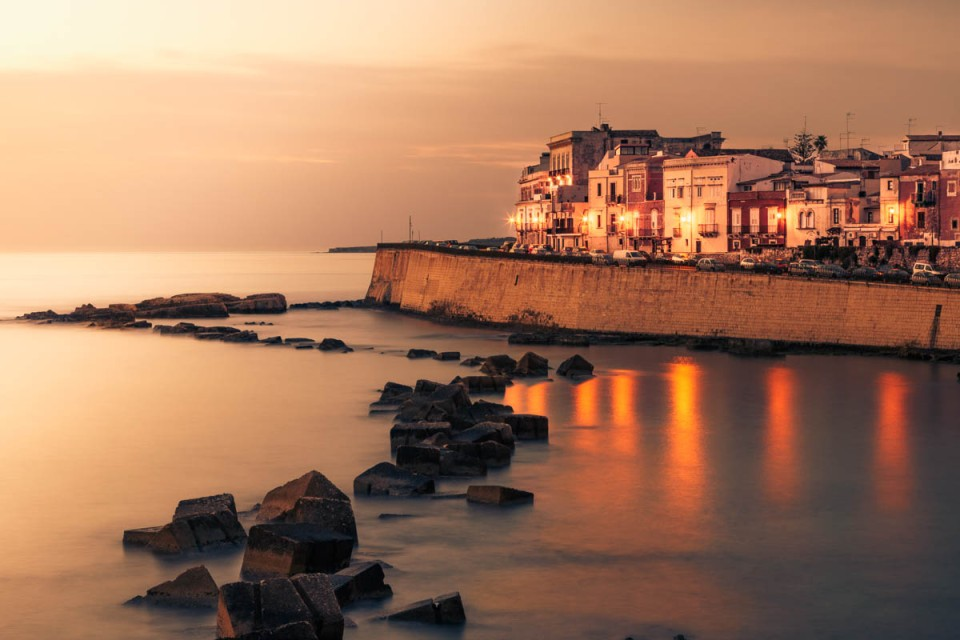 The waterfront of Ortygia, Syracuse at dawn, Sicily, Italy.