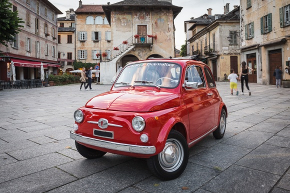 Little red Fiat 500 in Orta San Giulio, Italy