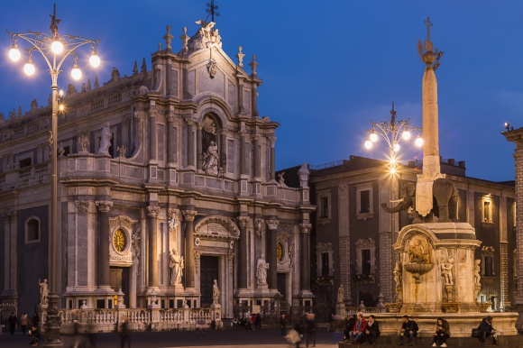 """Piazza del Duomo square with the façade of the cathedral and the Elephant Fountain """"u Liotru"""", symbol of Catania, Sicily, Italy."""