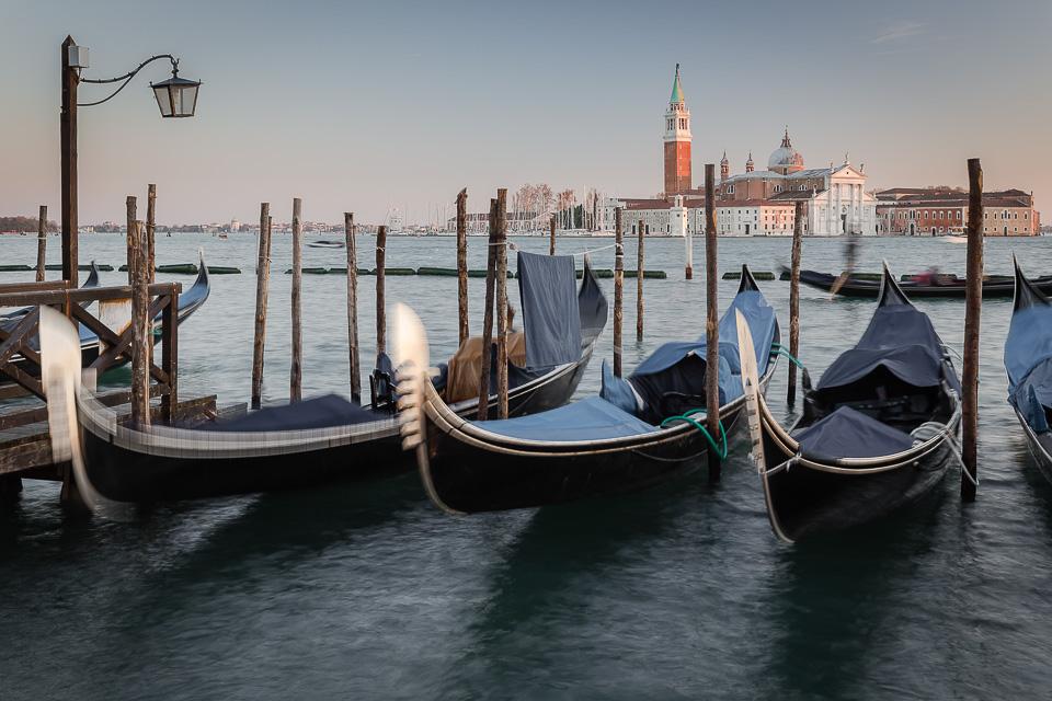Gondolas moored in front of the church of San Giorgio Maggiore, Venice, Italy