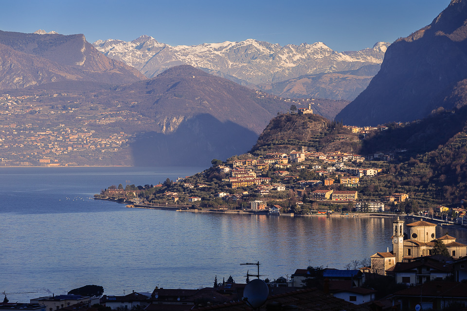 Lake Iseo seen from Sale Marasino to the north and the Alps, Lombardy, Italy