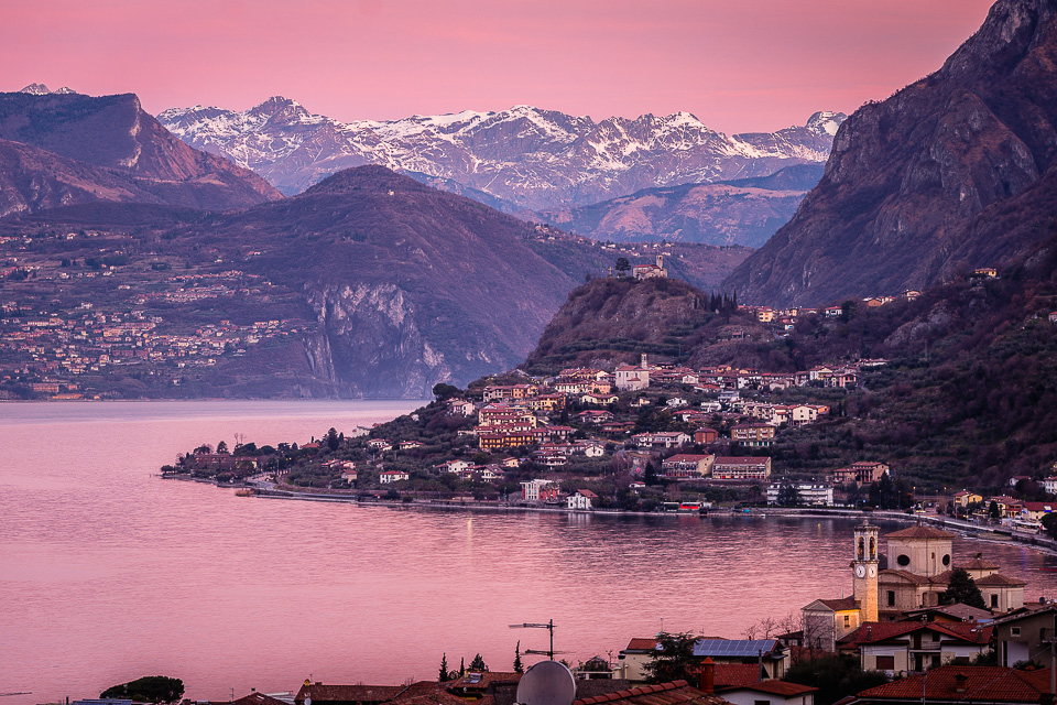Lake Iseo at dawn, seen from Sale Marasino to the north and the Alps, Lombardy, Italy