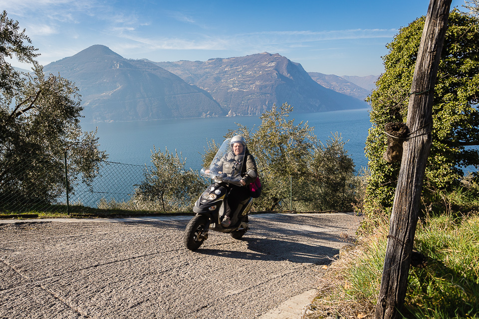 Scooter rider on Monte Isola, Lake Iseo, Lombardy, Italy